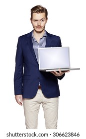 Photo of young businessman holding his laptop with copy space.