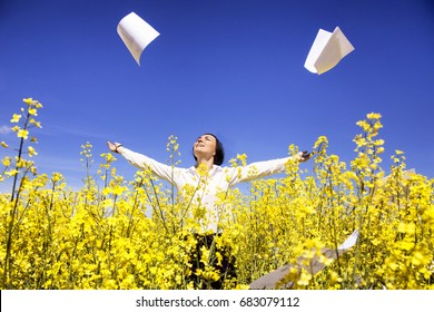 photo of Young businesswoman among yellow flowers  throw papers freedom
