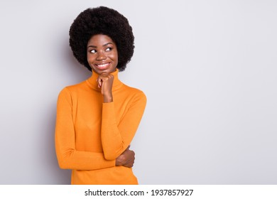 Photo of young cheerful black woman dream dreamy think look empty space hand touch chin isolated over grey color background