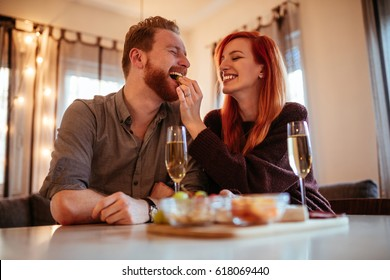 Photo of young couple enjoying spending time together dating at home.