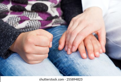 Photo of young doctor hand on the childs hand