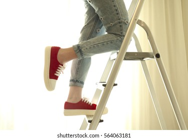 Photo of young girl climbing on ladder step by step