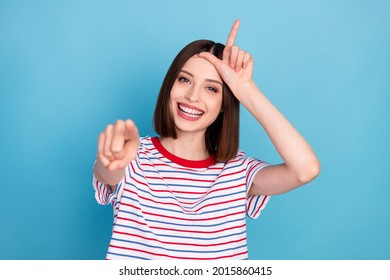 Photo of young girl happy positive smile point finger you bully abuse mocking loser isolated over blue color background