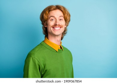 Photo of young handsome cute funky funny smiling positive man with wavy hair and mustache isolated on blue color background