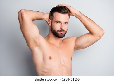 Photo of young handsome serious man enjoy hair treatment conditioner isolated over grey color background