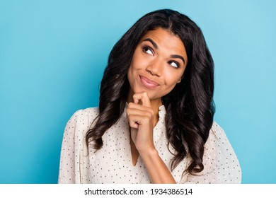 Photo of young happy positive smiling thoughtful minded afro girl look copyspace thinking isolated on blue color background