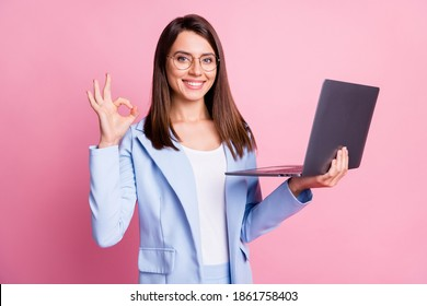 Photo of young happy smile girl hold laptop show okey deal done cool sign isolated over pastel color background
