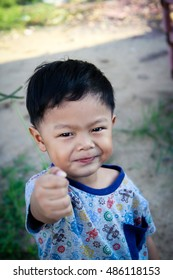 photo of a young happy Thai boy.