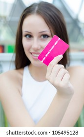 Photo of young joyful woman with shopping bags inside mall. holding new credit card