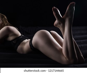 Photo of young lying girl in black lace panties