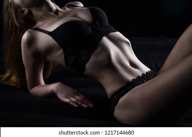 Photo of young lying woman in sexual underwear
