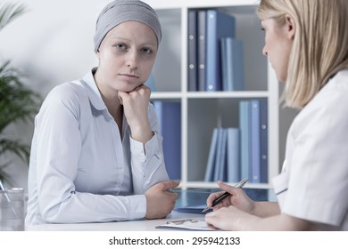 Photo of young pale cancer woman with scarf on head