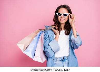 Photo of young pretty lady look sale shopping hold bags wear sunglass cool isolated on pink color background