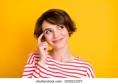 Photo of young pretty lovely happy smiling cheerful girl look copyspace thinking isolated on yellow color background