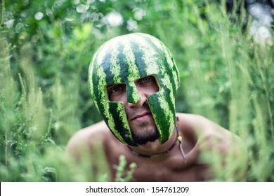 Photo of the young soldier with a water-melon on a head