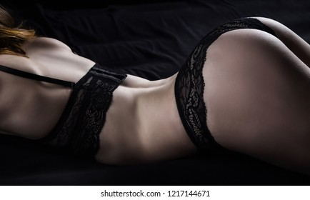 Photo of young woman in black lace panties