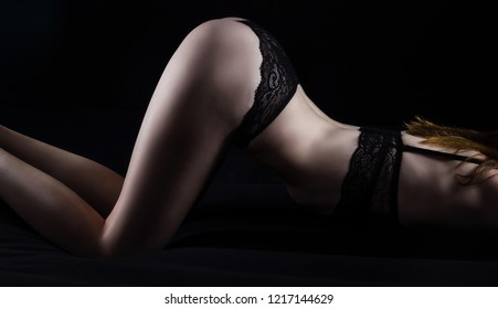 Photo of young woman in black panties