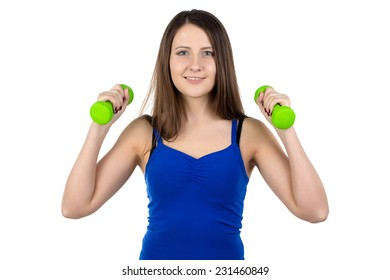 Photo of young woman with the dumbbells on white background