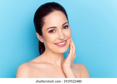 Photo of young woman happy positive smile hand touch cheek perfect silky skin cream collagen isolated over blue color background