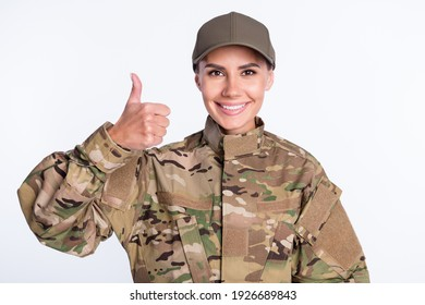 Photo of young woman happy positive smile soldier army wear uniform show thumb-up like cool isolated over white color background