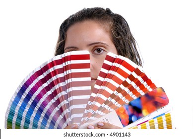 Photo of a young woman holding a color guide, focus on the eye