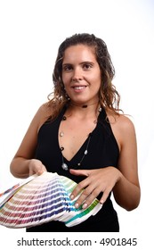 Photo of a young woman holding a color guide