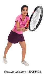 Photo of a young woman playing tennis over white background.