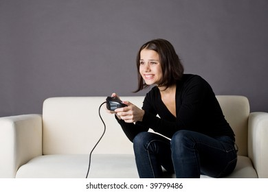 A photo of a young woman playing video games