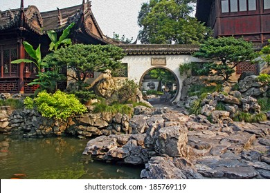 Photo of  Yuyuan garden in Shanghai with moon gate, pavilions and rocks, stylized and filtered to resemble an oil painting.