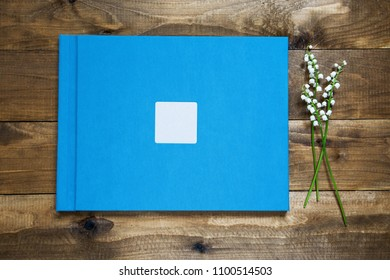 Photobook album in linen hardcover with metalic  frame and empty area for your text or design
