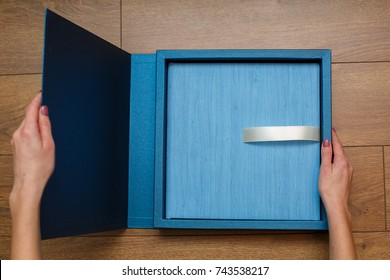 photobook in the cover of a blue leatherette a photo album on a wooden background photobook in a gift cardboard box A photo album in a beautiful package photo book pages