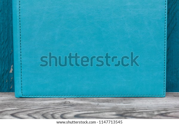 photobook with leather cover. Photo book on a bright background.  Photo album on a wooden surface.