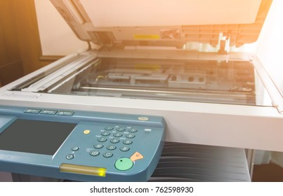 photocopier is a machine that makes paper copies of documents and other visual images ,close-up  multi-function device, printer scanner, copier.photocopier with  luminous sunrise or sunset