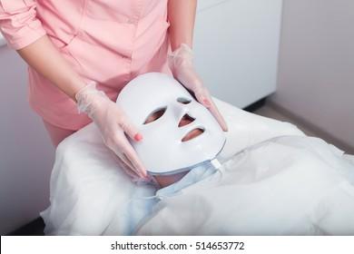 Photodynamic face mask therapy