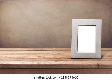 Photoframe with empty space on wooden table