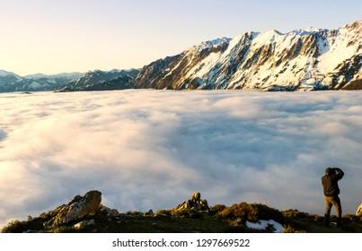 A photografe fog and cloud snow mountain valley landscape. View of Aramo Mountain, Asturias, Spain.