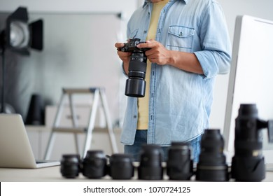 Photograper choosing objective for his digital camera