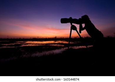 Photograper at sunset