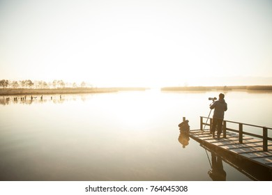 photograper taking pictures on lake