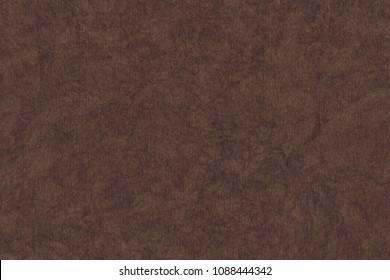 Photograph of artist's coarse grain dark brown pastel paper mottled grunge texture sample