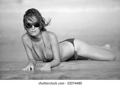 Photograph of a beautiful woman on the beach in Goa