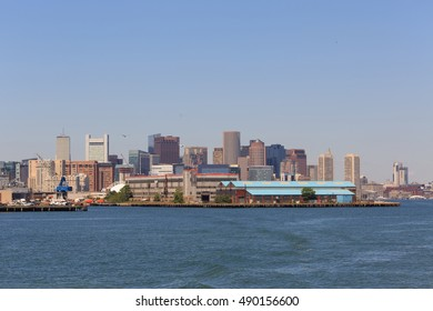 A photograph of the Boston Skyline, as seen from a boat on Boston Harbor. Boston is the capital and largest city of Massachusetts in the United States.
