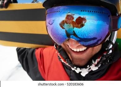 Photograph with camera in snowmask reflection