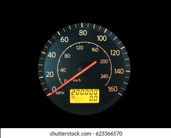 Photograph of a car speedometer with exactly 200,000 miles on the odometer.  Isolated on black.  Concepts could include age, reliability, transportation, other.
