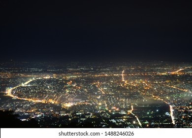 Photograph of Chiang Mai cityscape at night time in rainy season.