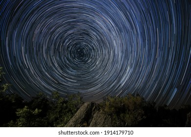 photograph of a circumpolar star trails with Pole Star at its center