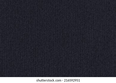 Photograph of dark Charcoal Black recycle striped paper, extra coarse grain, grunge texture sample.