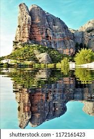 Photograph of the defiles of mallos of Riglos, Agüero, reflected in a lake,tourist destination, rock formations, erosion, geology, geological interest, murallones, ideal for mountaineers,Huesca, Spain