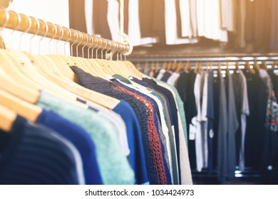 photograph of different colored clothes in the modern shopping centre