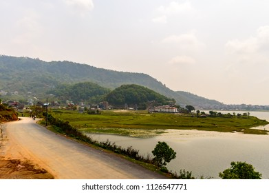 Photograph of empty road with hill in surrounding near Pokhara Lake at Kathmandu Nepal. Snap in portrait, landscape, wide screen style. Vintage film look. Vacation Freedom, Simplicity Concept.